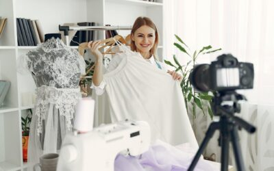 Woman filming a video of herself holding a dress